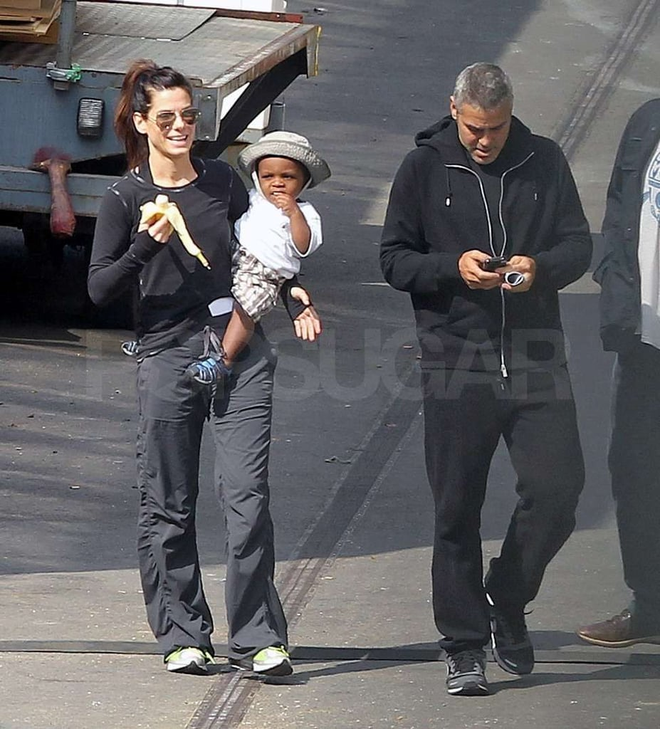 George Clooney, Sandra Bullock, and Louis on the Gravity Set