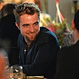 Robert Pattinson chatted with his fellow auction bidders.