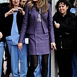 Queen Letizia wearing a purple suit set.