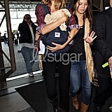 Gisele Bundchen Carries Benjamin Brady in an Ergo!
