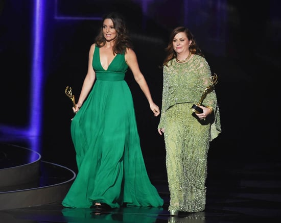 Tina Fey and Amy Poehler complement each other in green at 2016 Emmy Awards