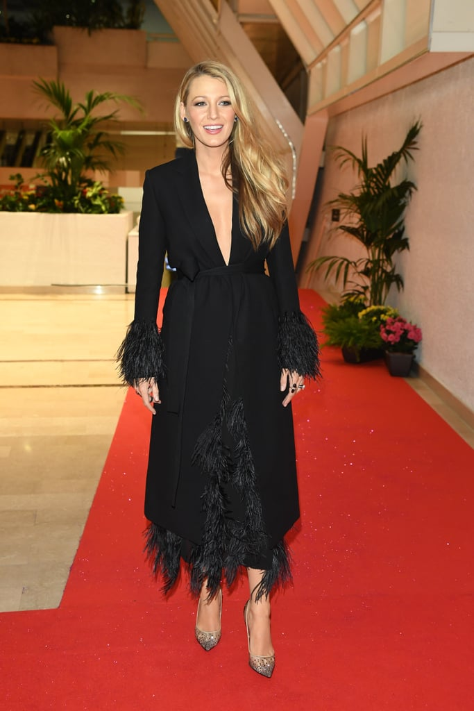 Heading to the opening night dinner, Blake Lively selected a black feathered Salvatore Ferragamo dress.
