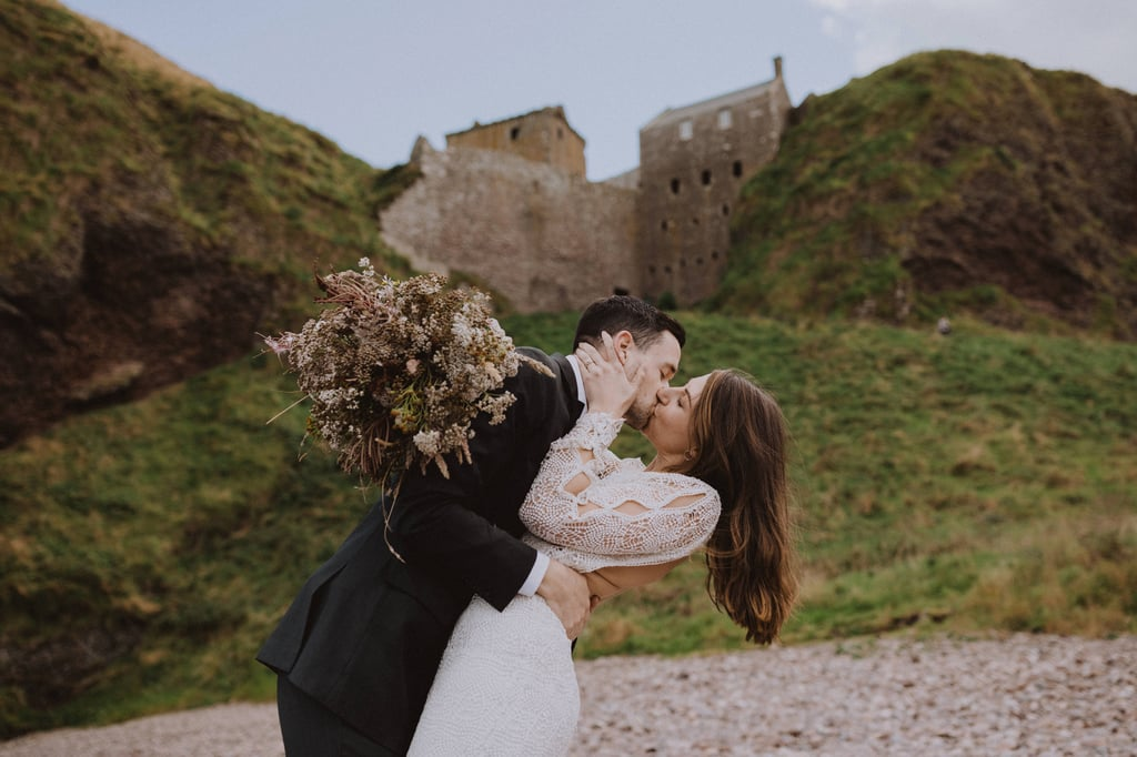 If you've seen Disney's Brave, this styled elopement shoot will look familiar. Taken at Dunnottar Castle in Northern Scotland — which inspired Merida and her family's Scottish Highlands home in the animated movie — photographer Gabriel Conover turned this royal landmark into a romantic elopement location, allowing the beautiful bluffs, medieval castle, and bride and groom to take center stage. The bride wore a backless lace dress with a plunging neckline and flower crown (made by photographer Gabriel himself!), while the groom wore a black tux. Taking into account the breathtaking setting and how happy these two look together, this shoot is all the elopement inspiration we need. See the stunning pictures, ahead.       Related:                                                                                                           You'll See Hufflepuffs in a Whole New, Romantic Light Thanks to This Themed Wedding Shoot