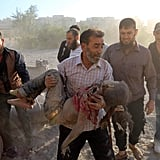 A man carries the body of a young girl after an airstrike in rebel-held territory near Damascus.
