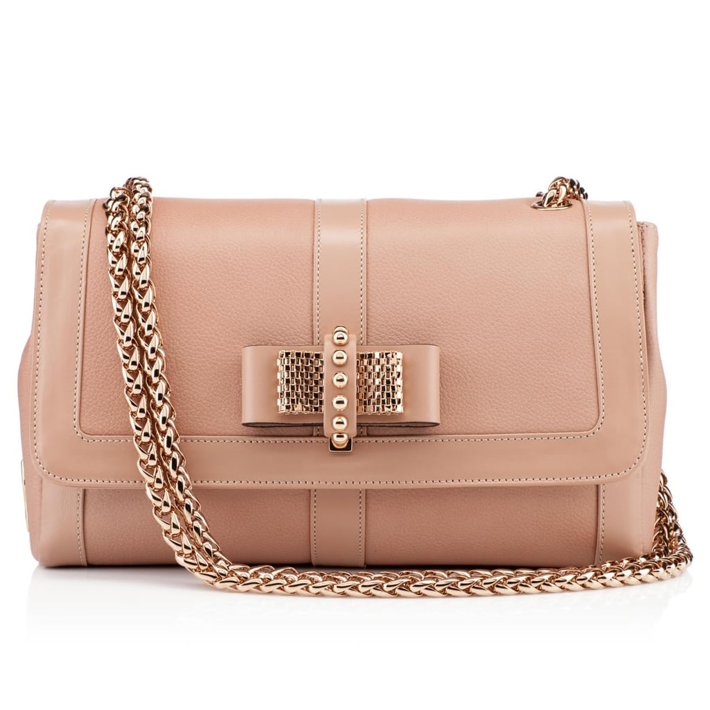Ladylike to the max, we love this blush leather, bow-bedecked purse ($1,595).