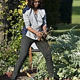 Michelle's khaki-colored All Star Converse play up her casual basics, like the two-tone sweater and jeans she wore in the White House Kitchen Garden in October 2013.
