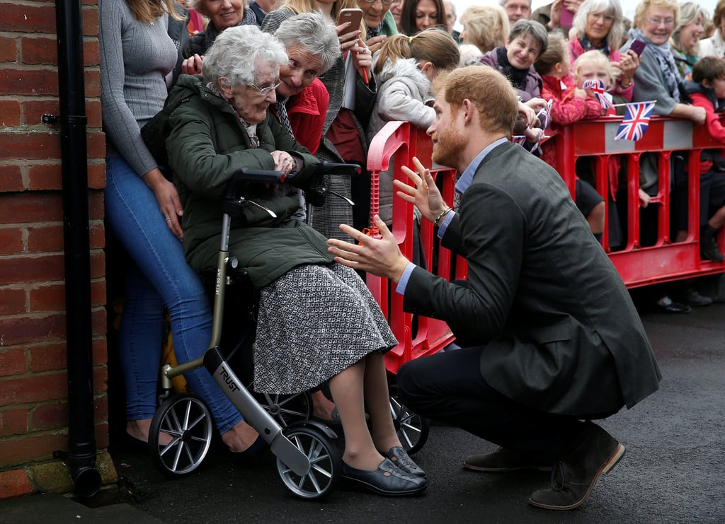 Prince Harry's dedication to helping others is truly inspiring. On Monday, the royal paid a special visit to Lancashire, England, where he carried out a series of philanthropic engagements that related to his areas of interest: veterans, conservation, and the use of sport to drive positive social change. Harry kicked off his day at Veterans UK in Norcross to mark the 25th anniversary of the helpline service, which aims to provide welfare support for veterans and their families. While there, Harry listened in on calls and met with the staff. The royal then followed up on his February 2016 visit to St. Michael's on Wyre when he officially reopened a village hall that was ravaged by flooding in 2015. He also met with children, but it was ultimately his precious reunion with 99-year-old Winnie Hodson, whom he first met in 2016, that really melted our hearts.      Related:                                                                                                           31 Times Prince Harry Was in Uniform and You Got Weak in the Knees               Later that afternoon, Harry stopped by Myplace at Brockholes Nature Reserve to roast marshmallows with a group of young children. The project aims to empower kids by encouraging them to take action in environmental activities, and Harry looked right in his element as he at around the campfire. For his final visit, the royal dropped by the UCLan Sports Arena, where he watched the Lancashire Bombers Wheelchair Basketball Club play and met with some of the center's members. It's safe to say that Harry is having one busy year!