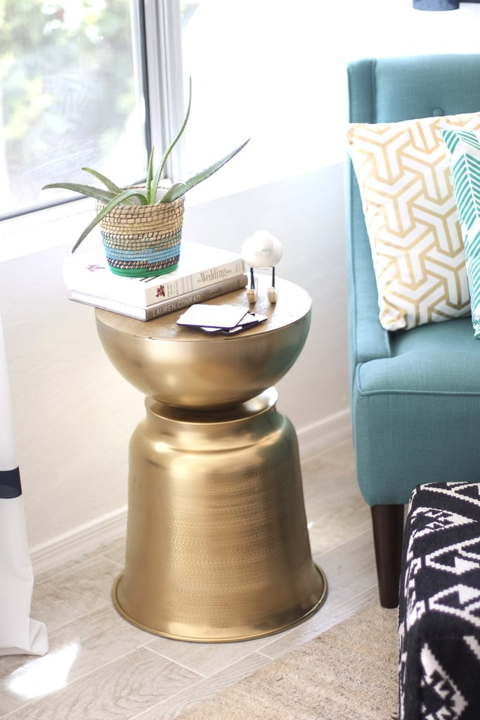 Gold and teal are her signature colors — why not decorate with them?