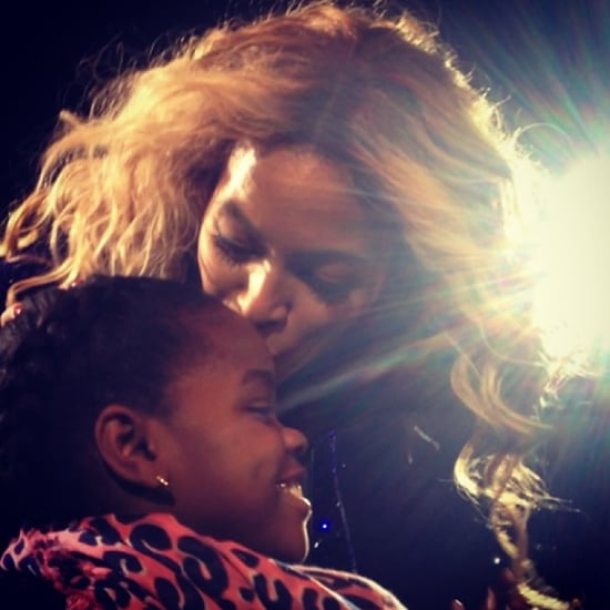 Beyonce Kisses Madonna's Daughter During Concert