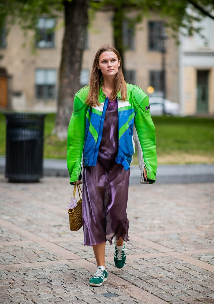 Styling a purple sheer dress with a green jacket.
