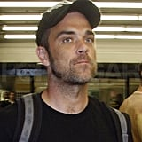 Photos of Robbie Williams and Ayda Field Returning From Haiti At Miami Airport