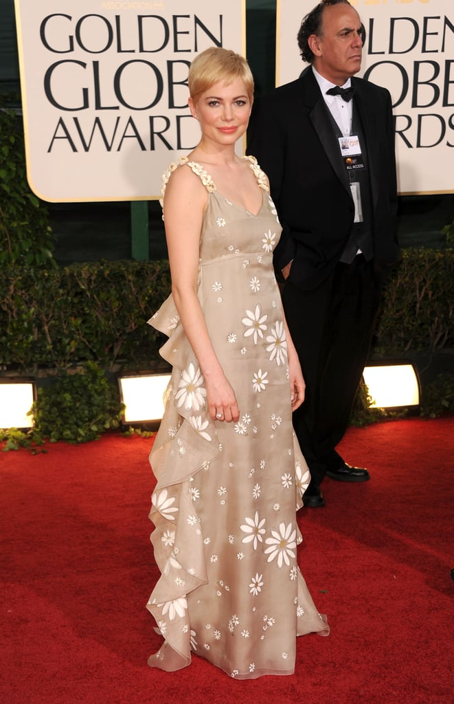 Michelle Williams made her latest red carpet appearance at yesterday's Golden Globes. She picked Valentino for the event, while on Friday she wore simple makeup and a Balenciaga dress for the Critics' Choice Awards. Michelle and her Blue Valentine costar Ryan Gosling were both on hand to see if their film takes home any awards.