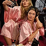 Gigi posed with Martha Hunt while the two prepped for their turns on the runway.