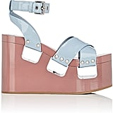 Slip into these chunky Miu Miu Patent Leather Platform-Wedge Sandals ($990).