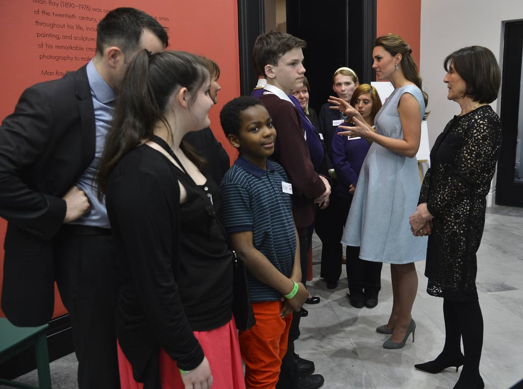 Kate Middleton showed off her growing baby bump while talking to a group of schoolchildren at the National Portrait Gallery in London in April.