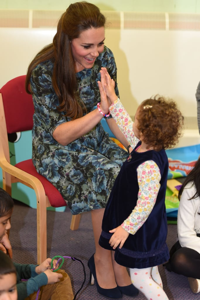Pregnant Kate high-fived this little cutie during a children's center visit in Smethwick, England, in February 2015.
