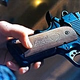 The Pistol With Negan's Symbol Carved Into it