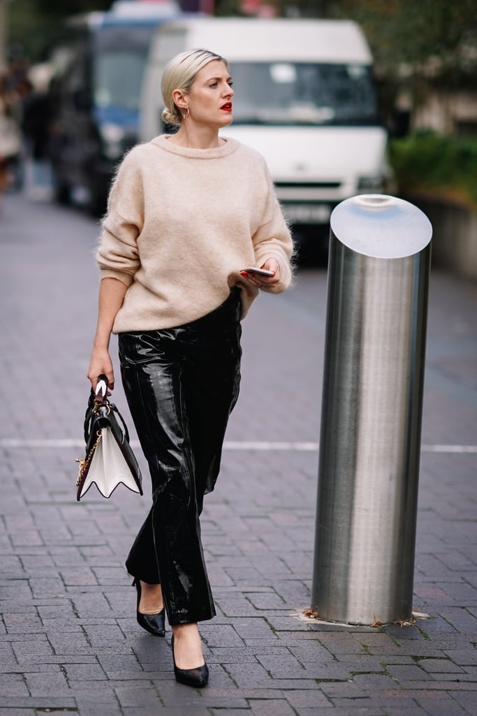 Blend a fuzzy cashmere jumper with leather pants instantly. All it takes is a neutral-toned colorblock purse or clutch.