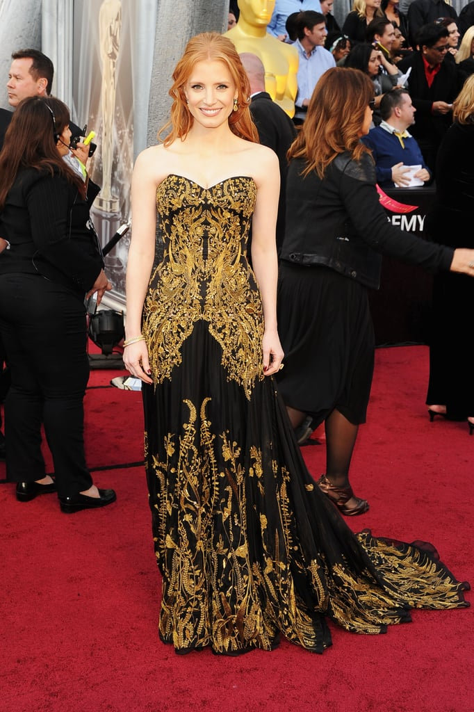 Jessica Chastain wore a strapless Alexander McQueen gown to today's Academy Awards in LA. She complimented the gown with $2 million of Harry Winston diamonds! It's Jessica's first time attending the ceremony as a nominee, and she even brought her grandmother along as her date! She's up for a best supporting actress honour for The Help. Jessica shares the accolade with her co-star Octavia Spencer, who will also be at this evening's show. The Help's in the running for best picture with eight other movies. What do you think of Jessica's long hair and gown combo? Weigh in on all the Oscars looks with Fab and Bella's polls.