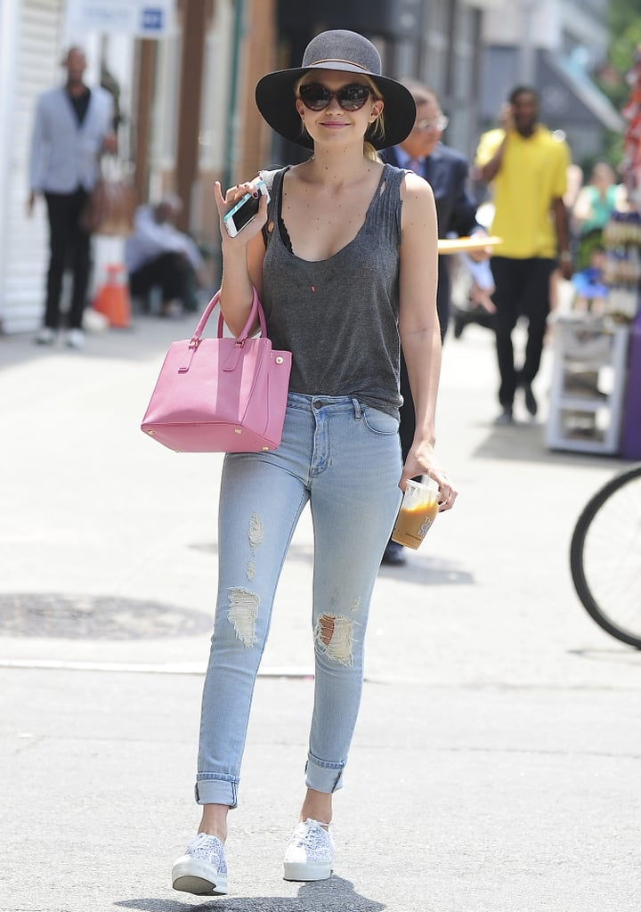 Hanging in Manhattan's East Village in the Summer meant dressed-down denim and a wide-brimmed hat.