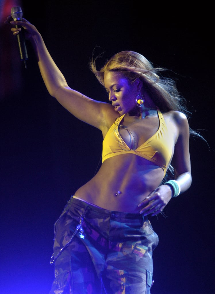 Beyoncé sported a yellow bikini top while performing at a Ford event in June 2003.