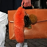 Fur accessories added a luxurious touch to this leather briefcase.
