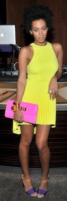 Solange Knowles in Yellow Dress, Purple Sandals, Pink Clutch