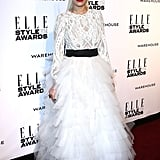 Perhaps wearing the most dramatic dress on the red carpet, Rita Ora's white floor-length gown from Marchesa's 2014 Autumn/Winter line is embroidered throughout the body and flares to a tulle skirt.