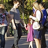 Tom Cruise and Suri Cruise visited Disneyland.