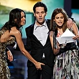Paul Rudd gamely fielded an advance from Rosario Dawson while onstage with  Eva Mendes at the Feb. 2011 Independent Spirit Awards.