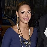 Beyoncé Knowles wearing a blue dress.