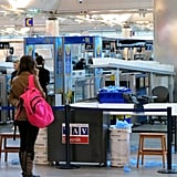 At the Airport: Watch the Security Line Bins