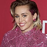 During her appearance at ONE Campaign and (RED)'s It Always Seems Impossible Until It Is Done 10th anniversary celebration in December 2015, Miley flashed a hot-pink patch of glitter on the sides of her hair to match her sequined ensemble.