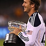 David Beckham held the match trophy after a game in Melbourne.