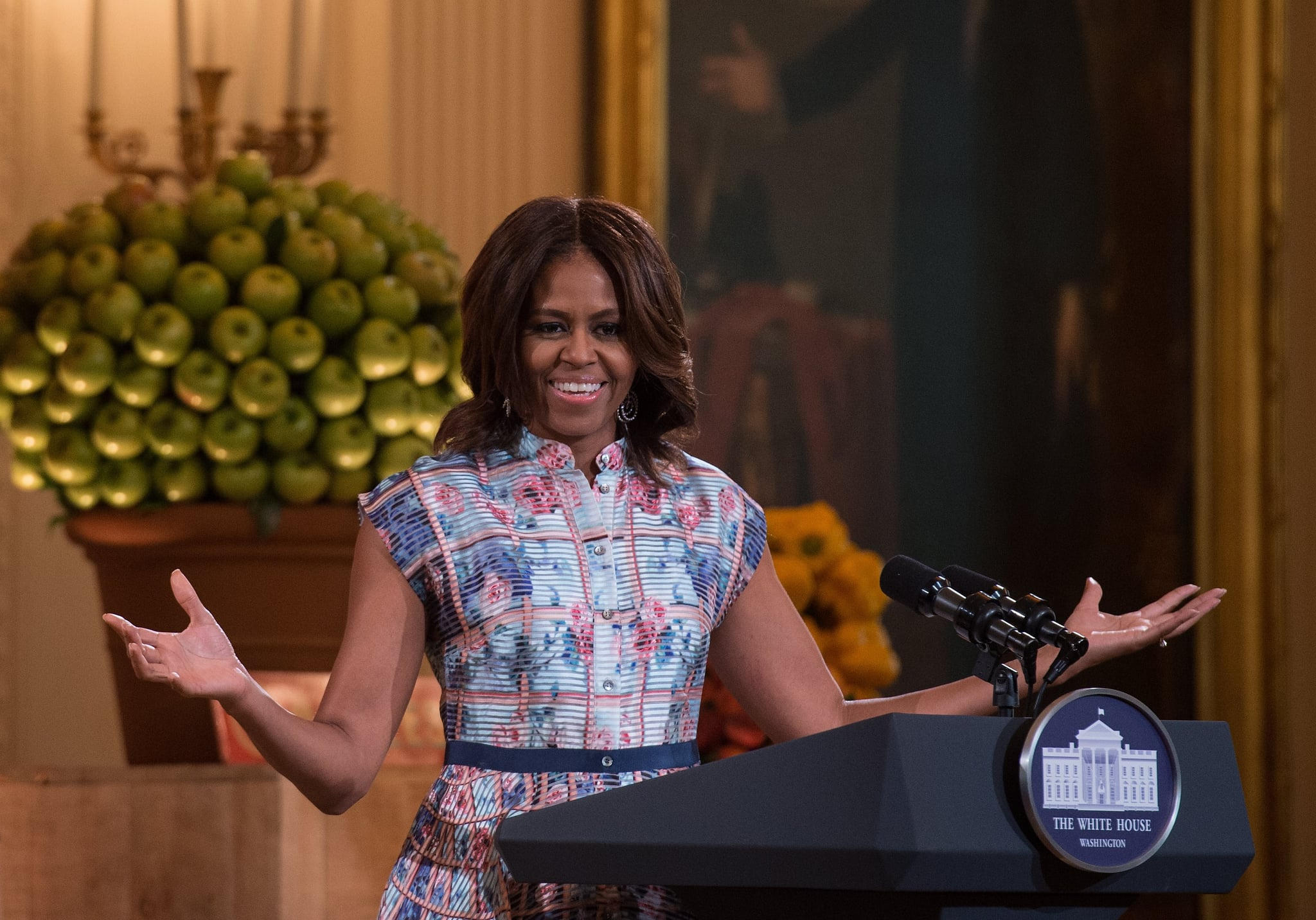 Michelle wore this ultramodern, fun, and floral Mary Katrantzou number to the Kids' State Dinner, accessorizing with simple, crystal-embellished dangling earrings.
