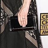 Emily Deschanel offset her lace dress with a sleek, metal-frame black clutch.