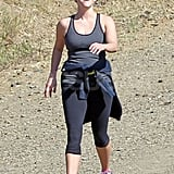 Reese Witherspoon goes on a walk with a friend in LA amidst pregnancy rumors.