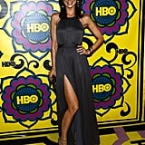 Perrey Reeves donned a moody gray halter gown with a leg-revealing slit and gold metallic heels.