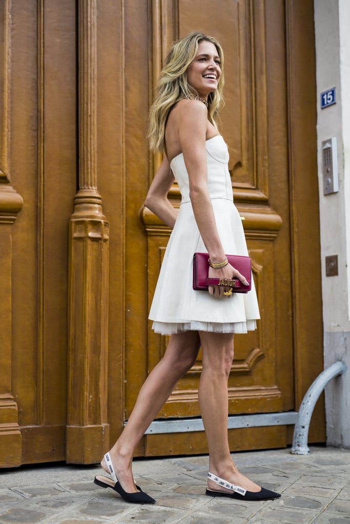 A great white dress is a Summer must-have. Reinvent it this season with chic flats.