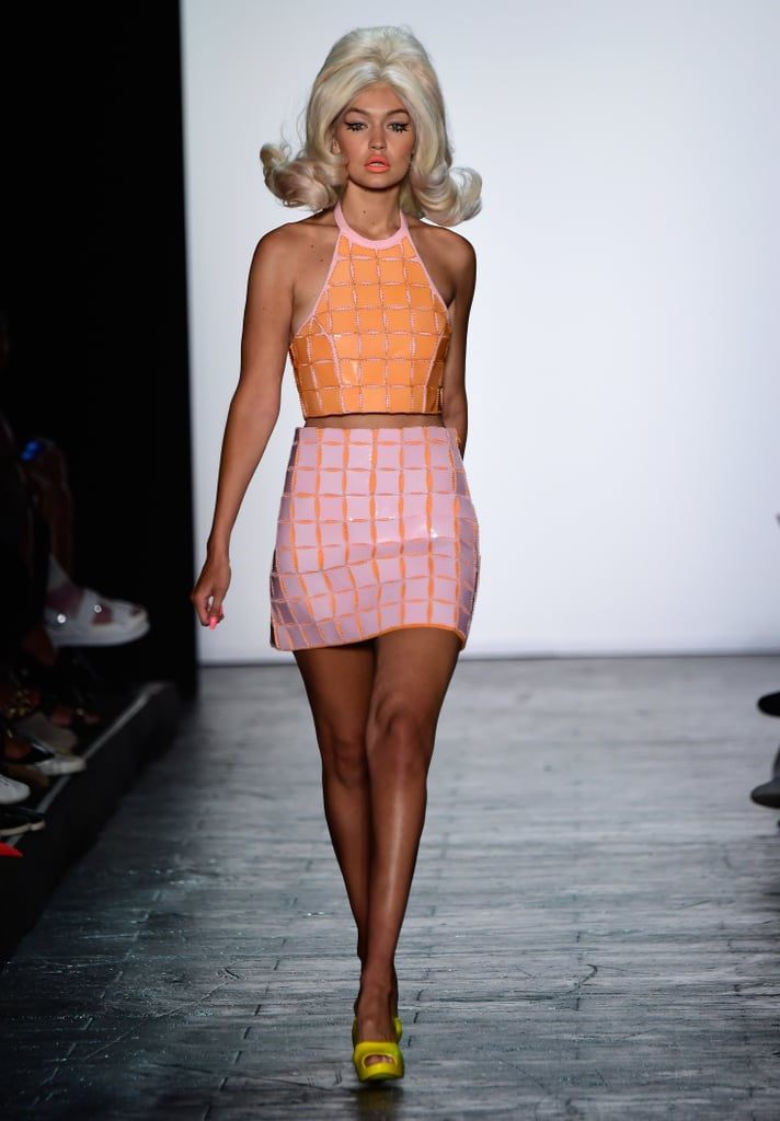 Gigi opened the Jeremy Scott show in a high-shine orange and pink coordinated set that was played up by a pair of bright yellow peep-toe pumps.