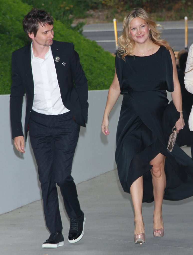 Kate Hudson's glamorous black gown showed off her toned legs as she and fiancé Matthew Bellamy stepped into a Chanel dinner to benefit the Natural Resources Defense Council's Ocean Initiative in Malibu last night. The expecting actress is still able to rock her sky-high heels, while Matthew kept his footwear of choice more casual. Kate and Matthew are sticking close to home in California for the final stretch of her pregnancy, which has meant lots of adorable afternoons watching her son Ryder Robinson play baseball and soccer. As the Summer heats up, perhaps we'll once again see Kate Hudson break out her bikinis and bare her baby bump as she awaits the arrival of her little one.