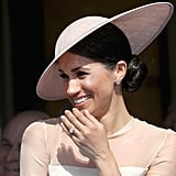Meghan Markle's Polished Buns and Blush