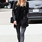 Nicky Hilton's gray and black speaks to the aesthetic perfectly — the leather accents, knit hat, and biker boots seal the deal.