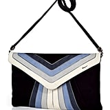 """""""I've loved this bag since I saw SJP sport a similar version; it's got all my favorite colors and the most beautiful metallic piping on rich navy suede, plus it goes from clutch to shoulder bag in a pinch!"""" — Noria Morales, editor Salvatore Ferragamo suede clutch with shoulder strap ($1,210)"""