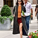 It was all about color blocking in NYC for Selena. She wore a gray plaid coat, orange sweater, corduroy burgundy Marc Jacobs skirt, and Golden Goose sneakers.