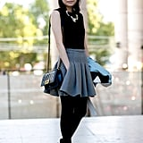Her gray skirt didn't just break up the all black, it lent a flirtier finish.
