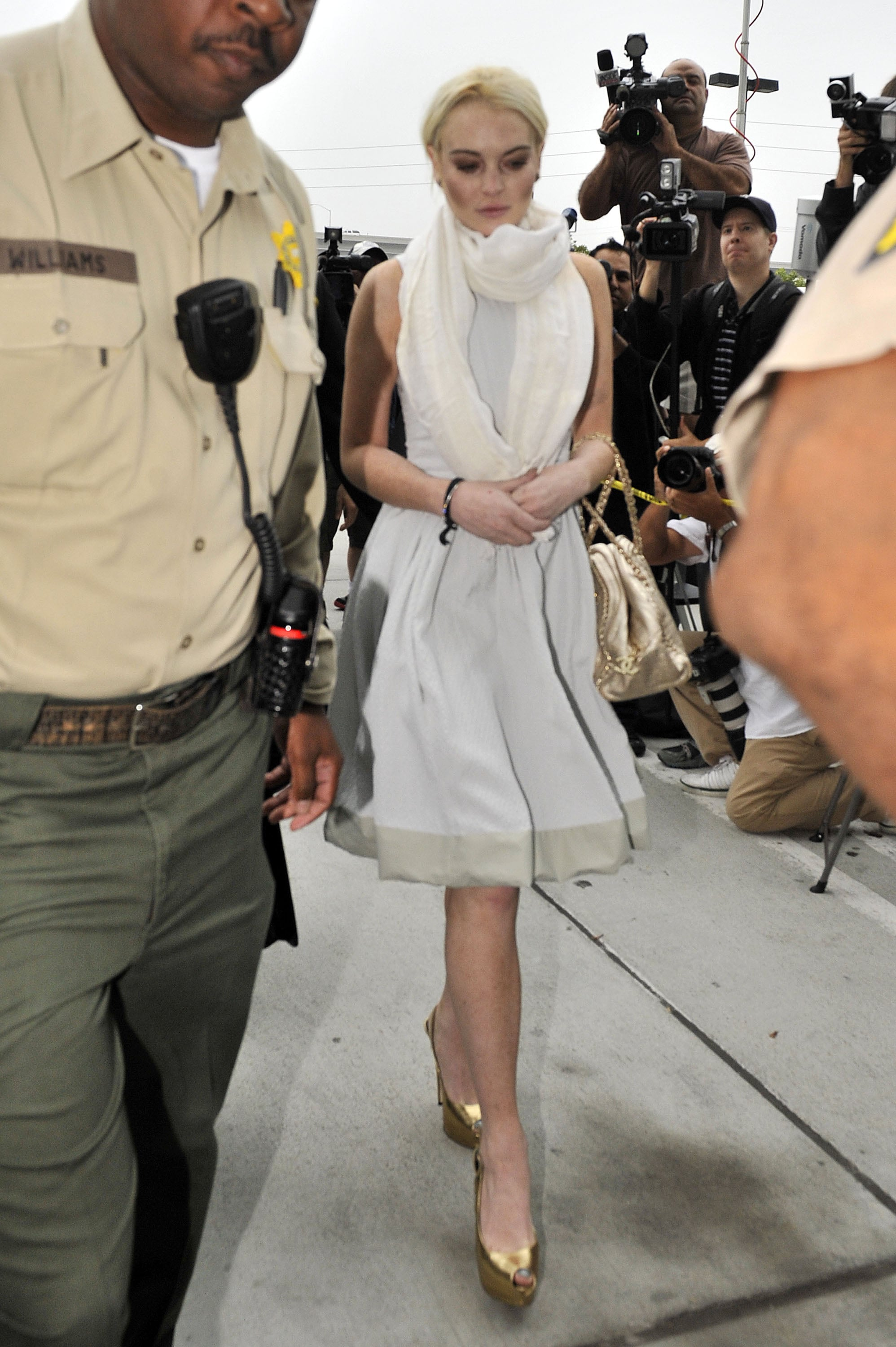 Lindsay Lohan was escorted to her hearing by police officers.