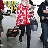 Sometimes all it takes is one piece to take your travel look to the next level. In Emma Roberts's case, it was a heart-printed sweater.