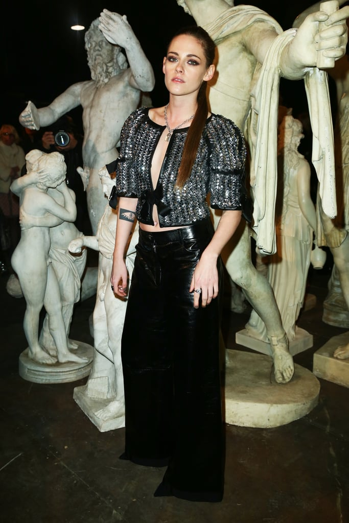 "Kristen Stewart popped up in Rome for the Chanel Métiers d'Art fashion show on Tuesday. The actress took a break from filming the movie Personal Shopper in Paris to attend the show; she posed for photos in a pair of high-waisted leather pants and a cropped, low-cut jacket and was also sporting extensions in her hair. Kristen is currently serving as the face of Chanel's Métiers d'Art campaign as well as muse to designer Karl Lagerfeld. She stars in the brand's short film, Once and Forever, as Gabrielle ""Coco"" Chanel, and will likely be wearing many a Chanel ensemble for her upcoming red carpet outings. Keep reading to see photos of Kristen's stunning appearance."