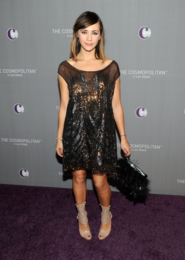 Rashida Jones's slouchy, sparkly black dress was a super-cool party look, and the feathered clutch was a perfect touch.